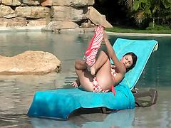 Sex-starved lady masturbates and toys her hungry cunt by a pool
