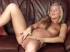 Rebecca fingers her juicy cave and toys it with a glass vibrator