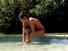 Horny little model with a tight body plays a solo on the poolside