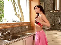Stunning brunette with lean body masturbates with a toy in a kitchen