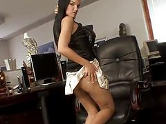 Solo brunette model pokes her clean shaven pussy with a toy